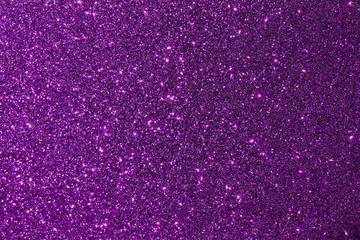 Dark purple color shiny glitter texture background with vibrant color