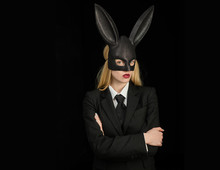 Sexy Woman Wearing A Black Easter Bunny. Lovely Woman In Rabbit Costume.