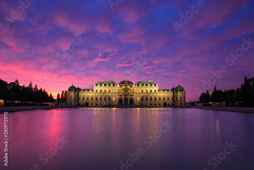 Foto auf Leinwand Aubergine lila The Belvedere Palace is a historic building complex in Vienna, Austria at sunset. Belvedere was built as a summer residence for Prince Eugene of Savoy.