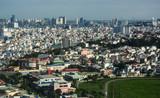 Fototapeta Do pokoju - Aerial view of cityscape in sunny day