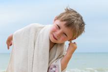 A Little Boy Cleans His Ear Fr...