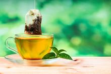 Herbal Tea Bag And Green Backg...