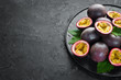 Passion fruits in a plate. Tropical Fruits. Top view. Free space for text.