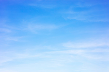 Blue sky background and white clouds soft focus, and copy space