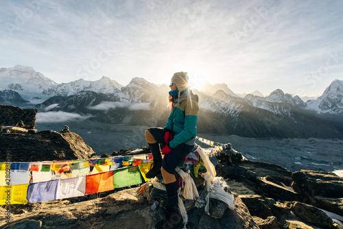 Obraz na plátne Female Tourist Hikking at gokyo ri mountain peak near gokyo lake during Everest