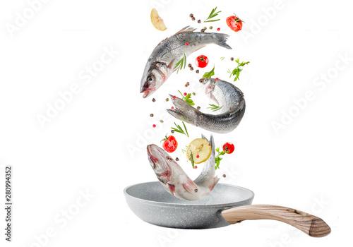 Cuadros en Lienzo Flying food, raw sea bass fish with spices