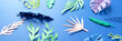 Leinwanddruck Bild - tropical leaves cut from paper on blue background.