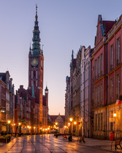 Dlugi Targ Street Looking Towards The Clock Tower Of The Museum At Night, Gdansk, Poland
