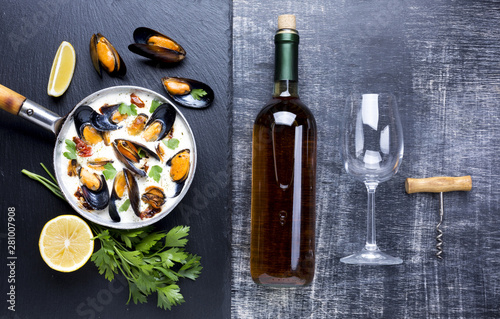 Fototapeta  Flat-lay mussels in white sauce and wine bottle