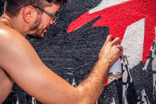 Graffiti Artist Painting A Wal...