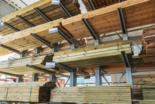 Shelves With Wooden Boards At Building Material Store