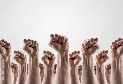 Photo  Large group of raised hands showing fists