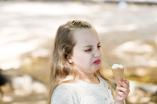 It Leaves A Bad Taste In The Mouth. Cute Little Girl Dislike Taste Of Ice Cream. Small Child Licking Ice Cream With Unpleasant Taste Impression. Her Ice-cream Just Doesnt Taste As Good