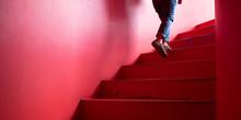 Man Walking Up Red Spiral Stai...
