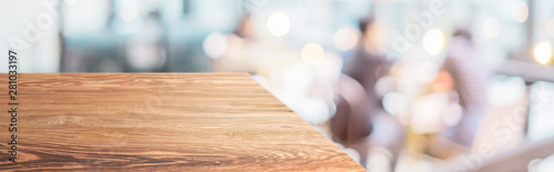 Fototapeta Perspective wood table with blur cafe restaurant with people dining background bokeh light.Panoramic wooden countertop banner mock up for advertising and product display design online content. obraz