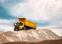 Dump Truck Drops Gravel