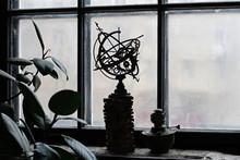 Celestial Globe And A Kerosene Lamp Standing On The Windowsill