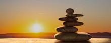 Zen Stones On Sunrise Backgrou...