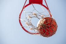 Ball In Basketball Net With Li...