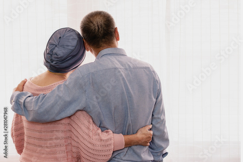 senior couple holding together with hands showing love and concern when wife wea Fototapeta