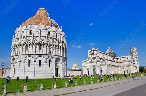 Wide angle view of Romanesque Baptistery of St. John Baptistry at Piazza dei Miracoli Piazza del Duomo popular tourist attraction in Pisa, Italy