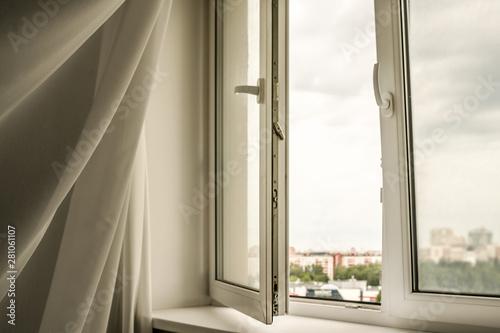 Fotografija wind blowing through open window in house, swaying curtain, room ventilation con