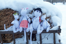 Moscow Region / Russia - 01 06 2019: A Fabulous Family Of Fictional Literary Characters. Moomintroll Dolls In The Puppet Theater Outdoors. Moomin Family Of Trolls In Snow.