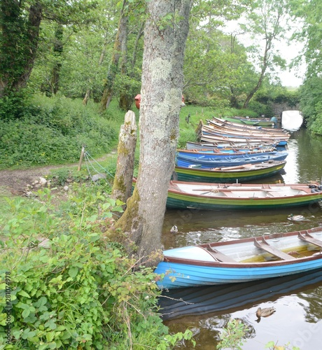 Canvas boats on the canal near Ross Castle in Killarney County, Ireland