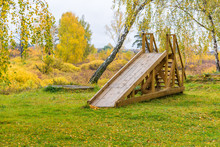 Abandoned Wooden Slide For Rid...