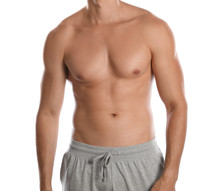 Young Man With Slim Body On White Background, Closeup View