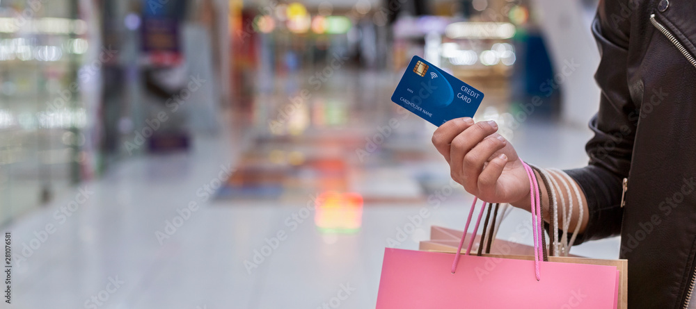 Fototapeta African woman with credit card doing shopping