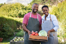 African Farmer Couple Holding ...