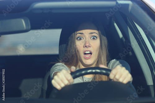 Obraz Scared driver driving a car before an accident - fototapety do salonu