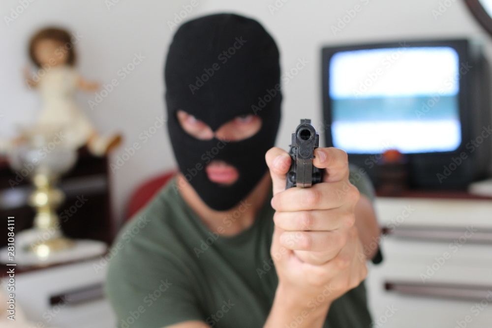 Fototapeta Armed robber entering a private property
