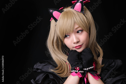 Fotografie, Obraz Japan anime cosplay , portrait of girl cosplay isolated in black background