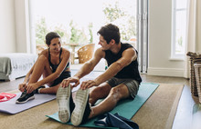 Couple Exercising Together At Home