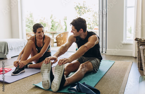 Fototapeta Couple exercising together at home obraz