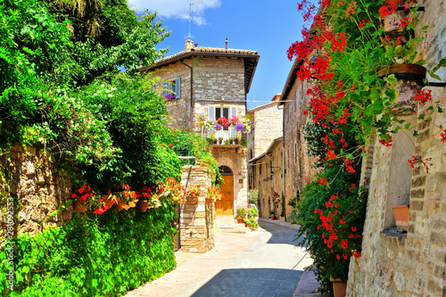 Fényképezés Flower filled medieval street in the beautiful old town of Assisi, Italy