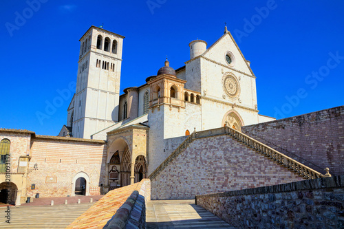 Fotografie, Obraz  Side view of the famous Basilica of San Francis of Assisi under blue skies, Ital