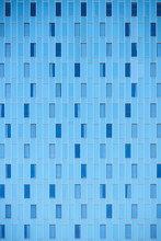 Blue Facade Of Modern Building With Windows