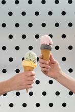 Hands Holding Double Ice Cream...