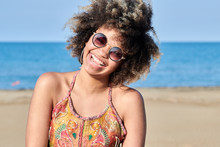 Pretty Laughing Girl In Stylish Sunglasses On Sunny Beach.