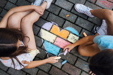 Girls Drawing With Chalks