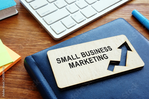 Fototapeta  Plate with sign small business marketing and notepad.