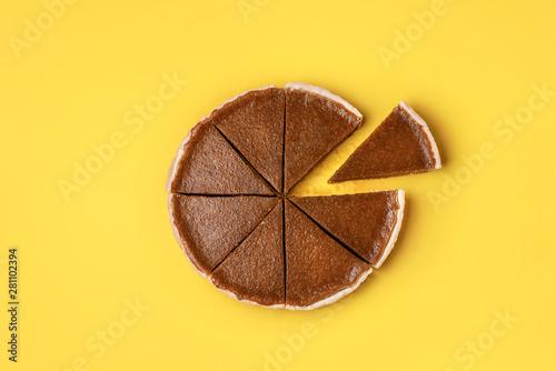 Cuadros en Lienzo Pumpkin pie cut in slices and one separated