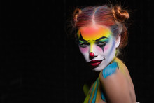 Charming Young Woman With A Face Painting Clow.