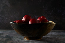 Close Up Of Red Plums In Bowl
