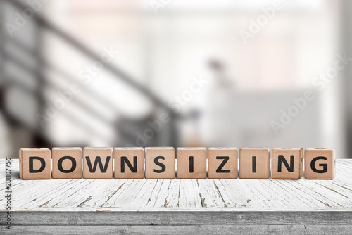 Photo  Downsizing message sign made of wood