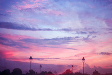 Double Exposure Of A Sunset With Streetlights In Paris, France