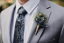 Groom Wearing Boutonniere With Thistle